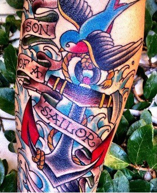 Colourful son of a sailor anchor tattoo on leg