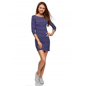 Beautiful woman wearing a blue navy dress with white horizontal stripes