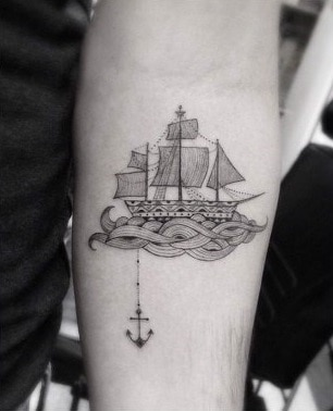 ship and anchor tattoo on forearm