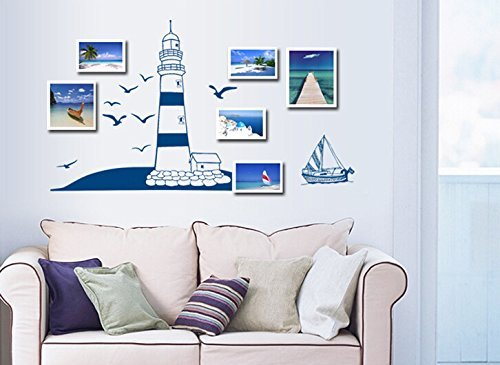 Living room with a nautical sticker on the wall above a sofa