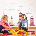 kids playing in a room with nautical wall stickers on