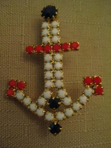 red stones anchor brooch